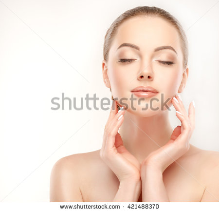 stock photo beautiful young woman with clean fresh skin touch her face facial treatment cosmetology 421488370